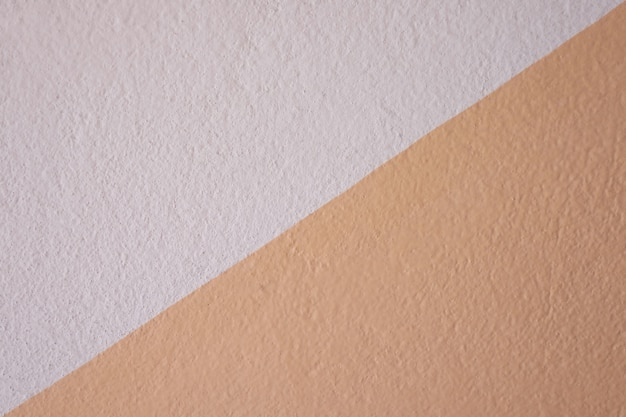 Textura concreta alaranjada da parede para o projeto em seu conceito do contexto do trabalho.