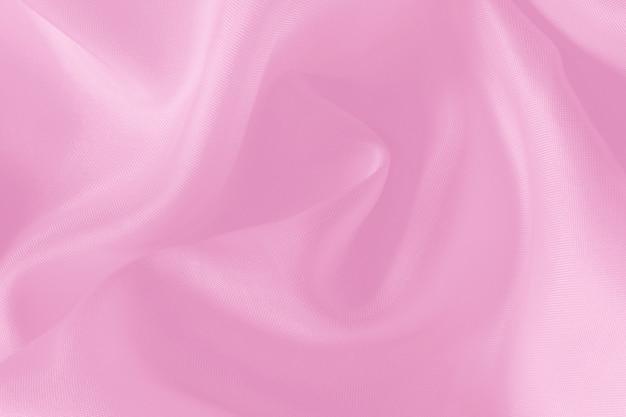 Textura cor-de-rosa da tela para o fundo e o projeto, teste padrão bonito da seda ou linho.