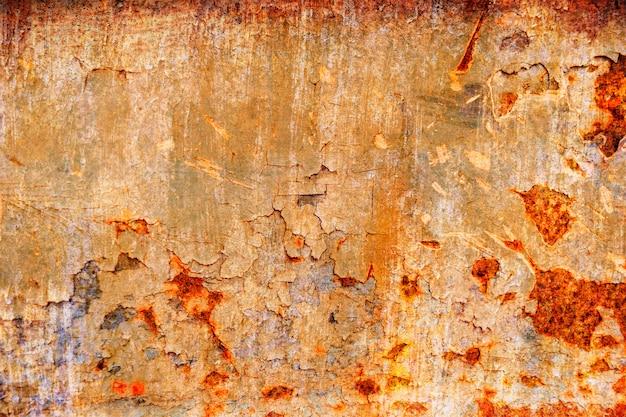 Textura coroded do metal de grunge. a placa de metal oxidada velha pesadamente envelheceu a mancha de corrosão.