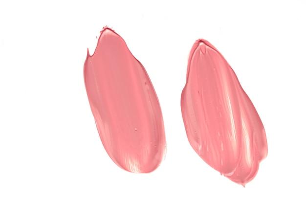 Textura cosmética de beleza coral isolada no fundo branco manchada maquiagem emulsão creme ou fo ...
