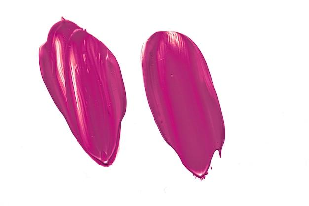 Textura cosmética de beleza roxa isolada no fundo branco manchada de creme de emulsão de maquiagem ou f ...