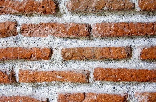 Textura da antiga muralha de tijolo vermelho