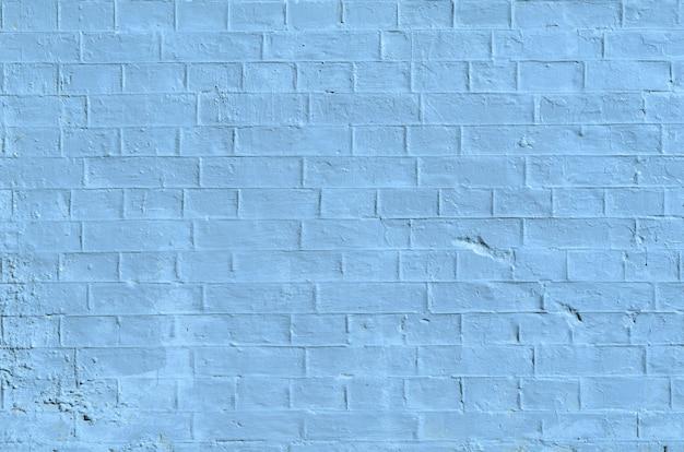 Textura da antiga superfície de parede de tijolo branco e cinza com costuras de cimento e concreto