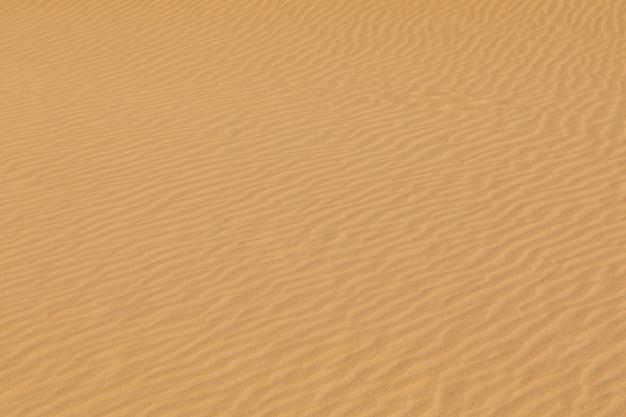 Textura da areia do deserto, padrão, superfície