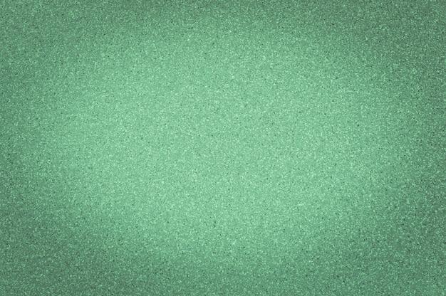 Textura da cor verde do granito com pontos pequenos, com vignetting, fundo do uso.