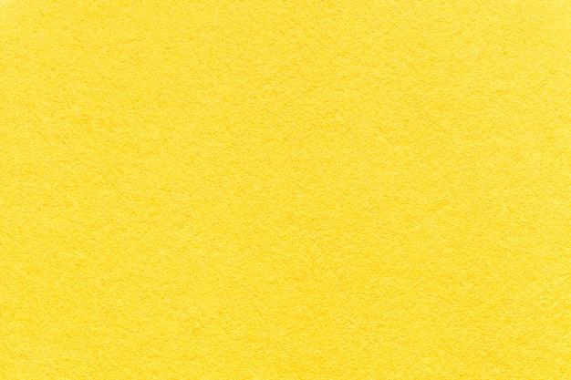 Textura da luz velha - fundo de papel amarelo, close up.