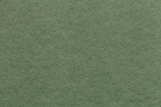 Textura da luz velha - fundo do papel verde, close up. estrutura de papelão de azeitona densa