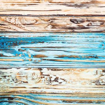 Textura da madeira estragada de cores