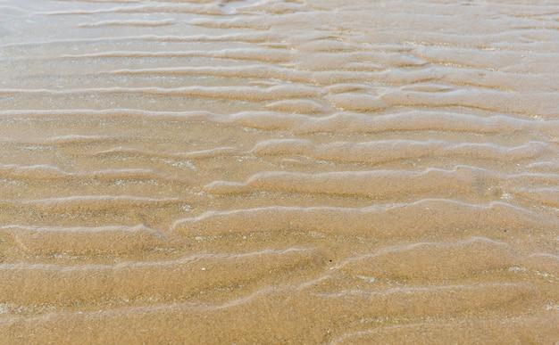Textura da natureza da areia. onda da textura da areia perto da praia.