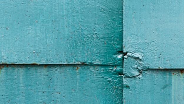 Textura da parede azul danificada