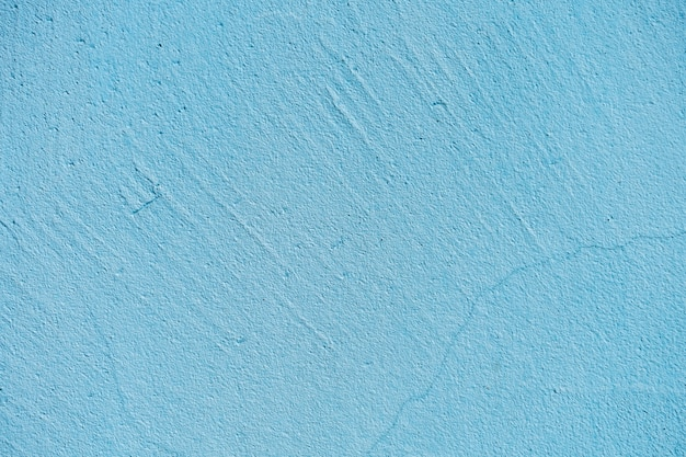 Textura da parede da pedra azul ou do cimento na luz solar para o teste padrão, a parede ou o 3d. horizontal, close-up