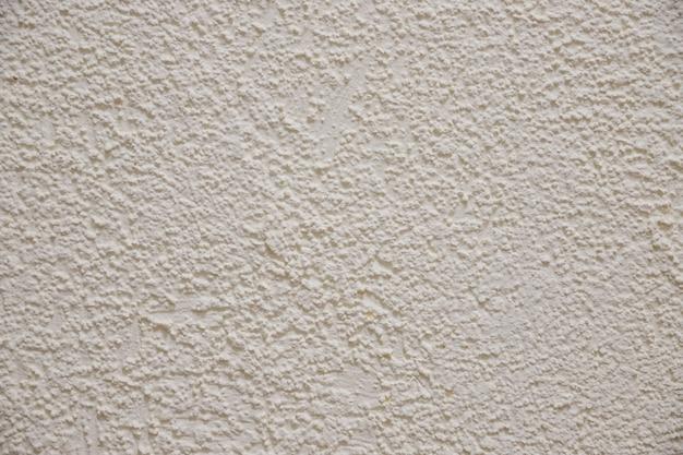 Textura da parede de cimento de cor bege. fundo de papel de parede de concreto afiado. fundo bege. parede de concreto.