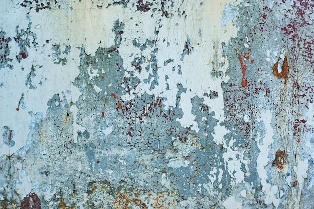 Textura da parede de ferro enferrujado vintage cinza com muitas camadas de tinta e ferrugem