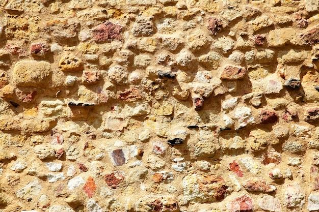 Textura da parede de pedra antiga, plano de fundo da arquitetura