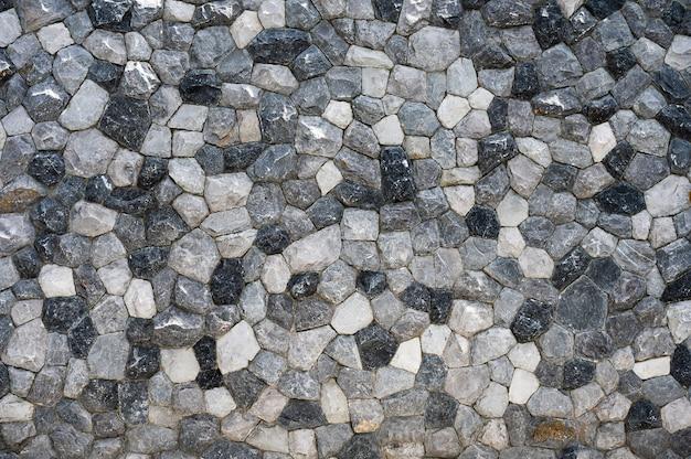 Textura da parede de pedra cortada empilhada seca. cerca de pedras naturais