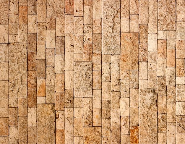 Textura da parede de pedra, telha quadrada amarela do travertino.