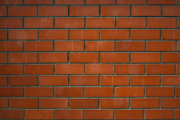 Textura da parede de tijolo vermelho.
