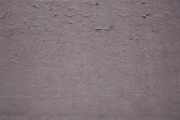 Textura da parede velha cor pastel cinza escuro rachado, a textura da tinta velha está lascando e rachada parede vintage de concreto de destruição de queda para o projeto.