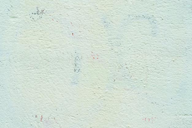 Textura da parede verde do estuque da casa velha.