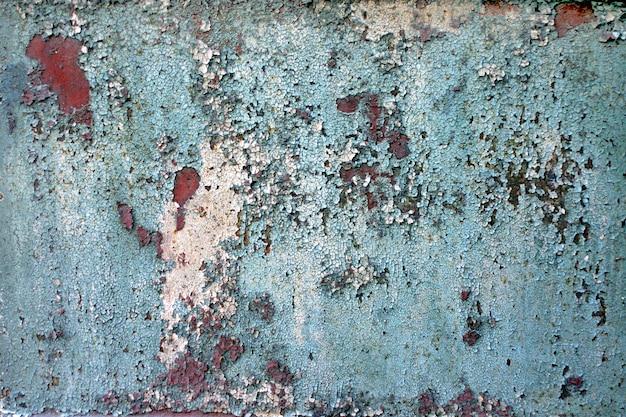 Textura da pintura rachada velha.