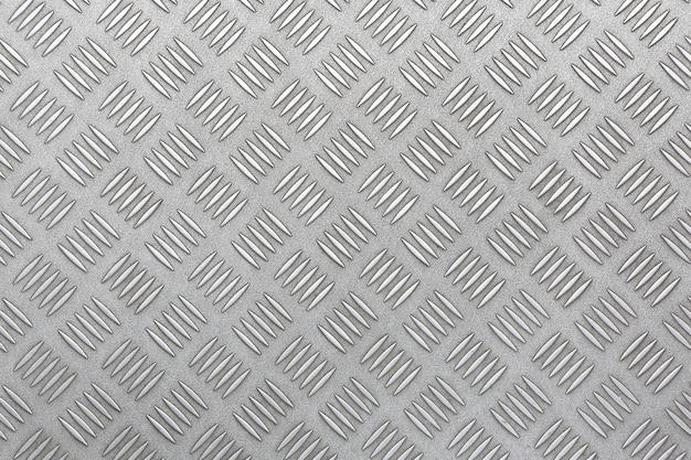 Textura da placa de metal do diamante.