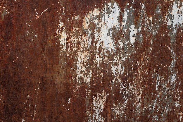 Textura da placa de metal velha oxidada com tinta branca rachada.