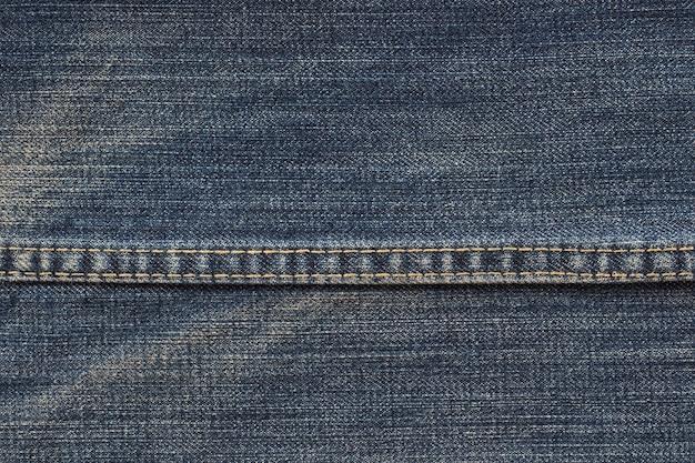 Textura da sarja de nimes no fim acima da vista com espaço da cópia para o fundo ou o papel de parede do vintage.