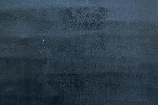 Textura da superfície de metal pintada velha cinzenta na luz solar para o teste padrão, a parede ou o 3d. horizontal, close-up
