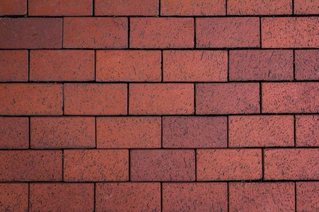 Textura da telha de concreto. fundo do pavimento da cidade. textura da calçada da rua.