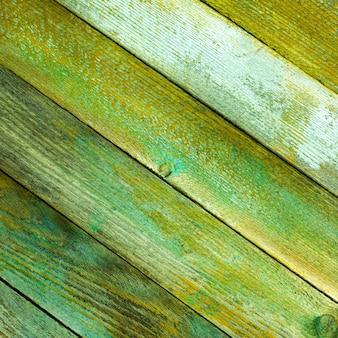 Textura das placas de celeiro de madeira velha com uma tonalidade verde