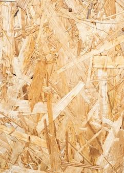 Textura de alta resolução da prateleira de madeira da prensa e do fundo para o projeto ou qualquer uso. fundo marrom de tábuas de madeira prensadas