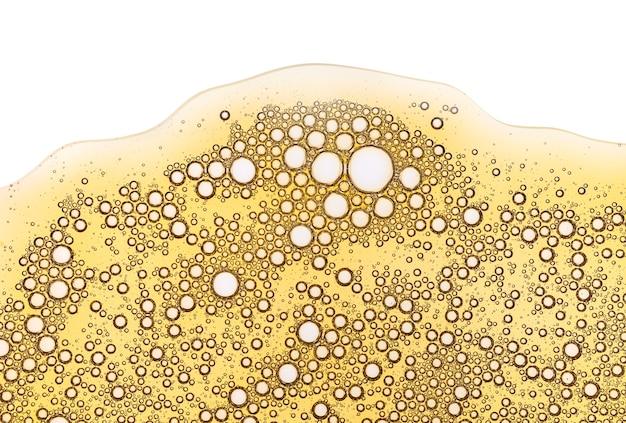 Textura de amostra cosmética transparente de gel creme amarelo com fundo de bolhas