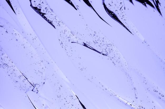 Textura de amostra cosmética transparente em gel creme com fundo de bolhas