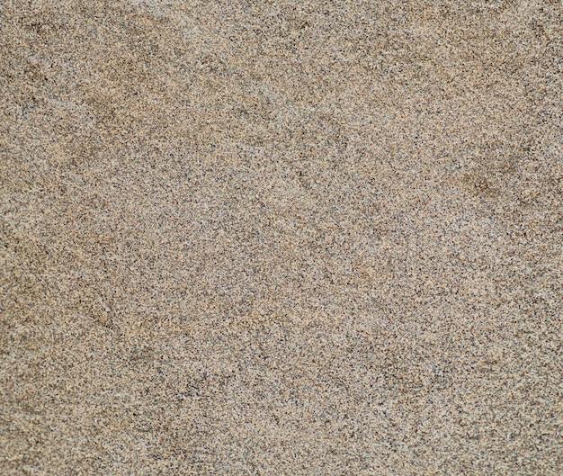 Textura de areia do detalhe da praia