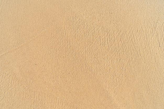 Textura de areia limpa. praia de areia tropical para banner de fundo de verão