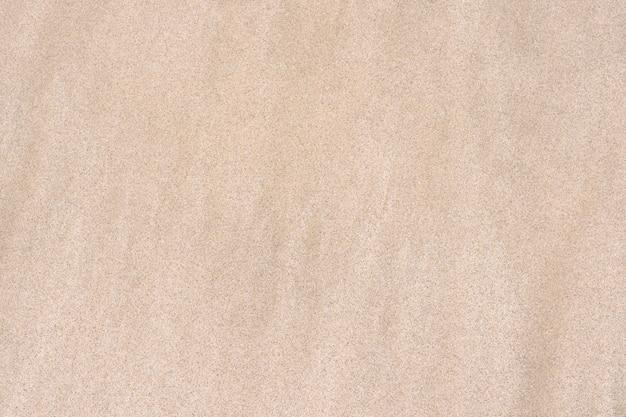 Textura de areia. praia de areia para o fundo.