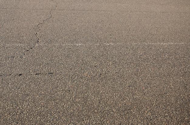 Textura de asfalto cinza sujo e sombrio