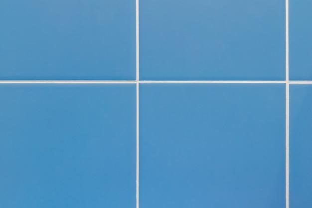 Textura de azulejos azuis. parede em um banheiro, banheiro ou cozinha