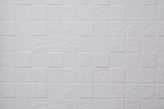 Textura de azulejos quadrados brancos na cozinha. geometria, estilo, design.