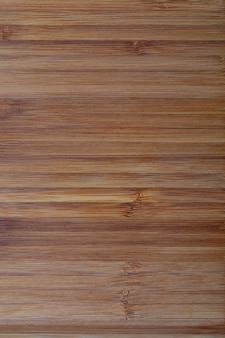 Textura de bambu rústica. linhas horizontais. ocre e tons de marrom.