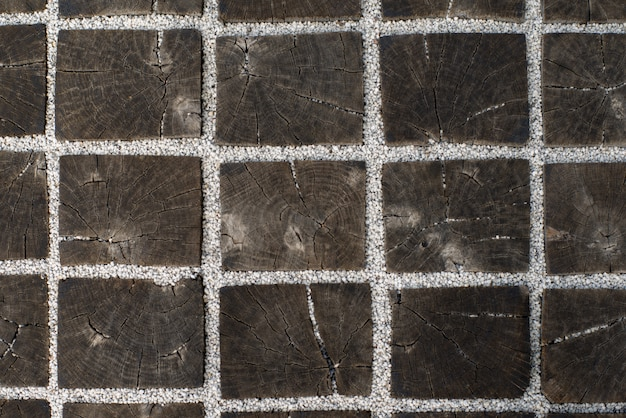 Textura de barras quadradas de madeira anexadas por seixos brancos