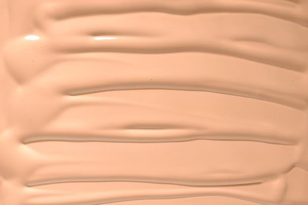 Textura de base líquida. compense para as mulheres. vista do topo.