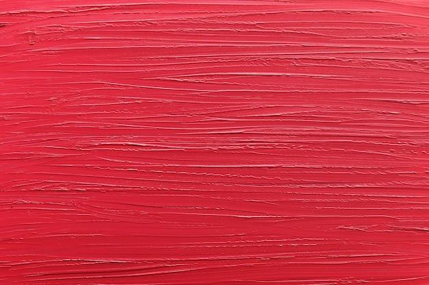 Textura de batom vermelho, brilho labial close-up. conceito da indústria da beleza.