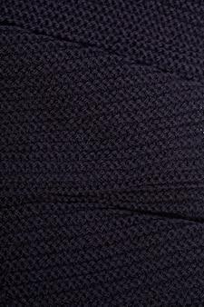Textura de cachecol preto de malha