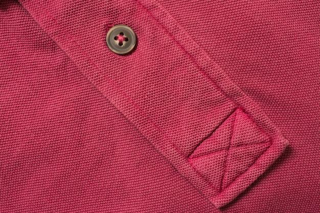 Textura de camisa polo vermelha, tecido de algodão. fundo de matéria têxtil