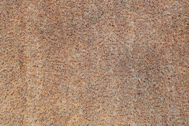 Textura de capacho marrom. textura de tapete natural.