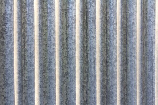 Textura de chapa metálica velha com tinta cinza gasta
