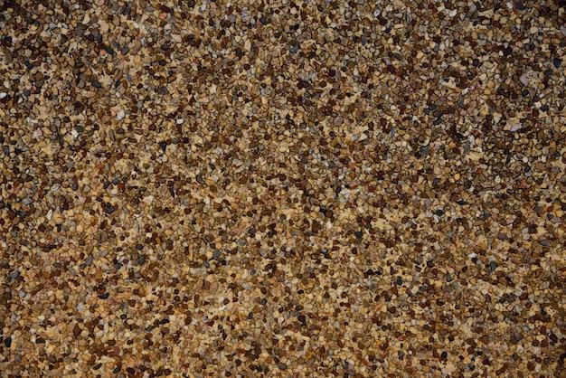 Textura de cimento de pedra marrom e fundo