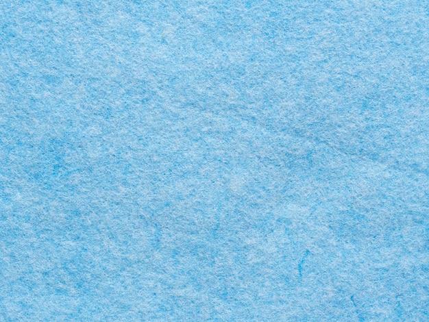 Textura de close-up de pano sintético azul para limpeza de casas