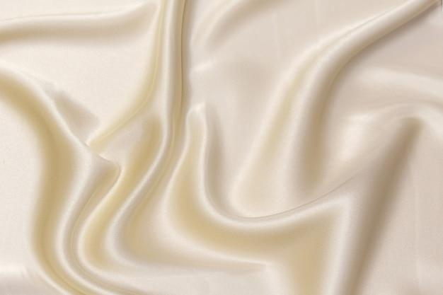 Textura de close-up de tecido bege natural ou pano na cor marrom. textura de tecido de algodão natural ou material têxtil de linho. fundo de tela bege.